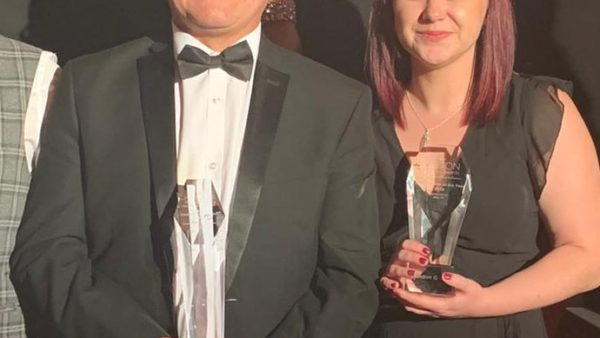 "Gary Carmichael and Cassie McMullin pictured with the coveted trophies. Overall ""Business of The Year"" and ""Manufacturer Of The Year."""